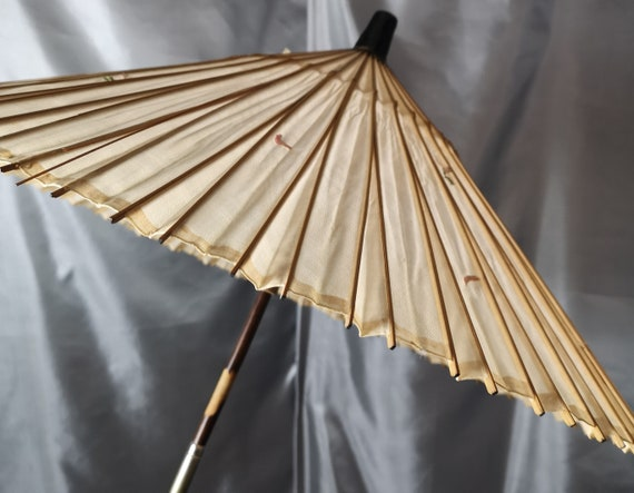 Antique Chinese silk parasol, two piece handle, carved bamboo