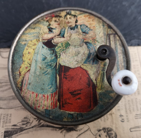 Antique wind up tin music box, childs toys