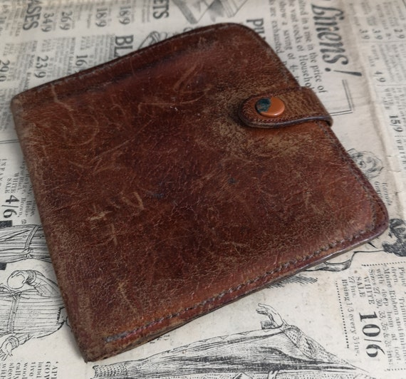 Rustic Vintage 40's leather wallet, worn and distressed, old currency