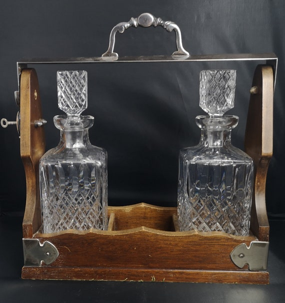 Antique tantalus, oak and silver plate, cut glass decanters