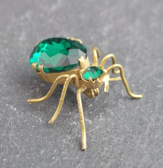 Antique gilt spider brooch, foil backed emerald green paste, bug brooch