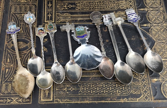 Collection of antique and vintage souvenir spoons, silver plated spoons