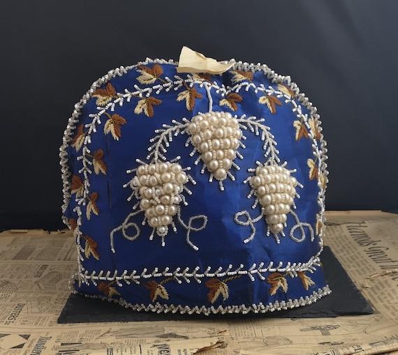 Victorian silk and beadwork tea cosy, grapevine