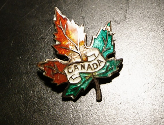 Vintage 30's sterling silver Canada brooch, silver and enamel leaf pin