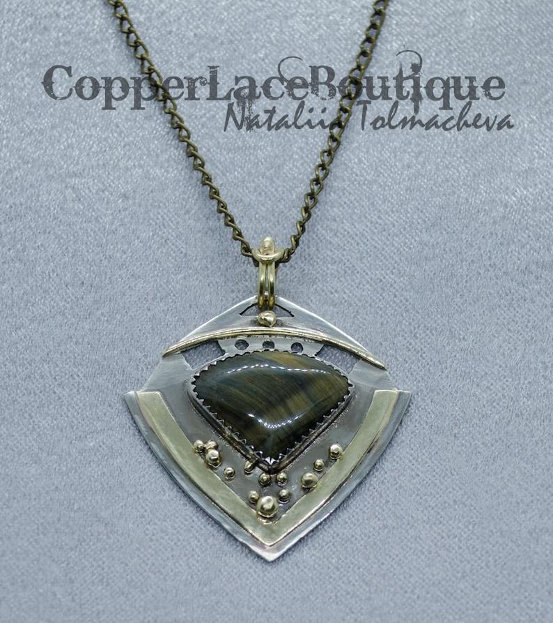Geometric pendant Geometric pendant with hawkeye. Pendant with Hawkeye