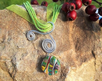 Silver necklace made of aluminum with its Green polymer clay bead