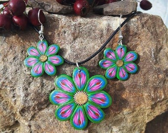 Green, blue and pink flowers set made of polymer clay.