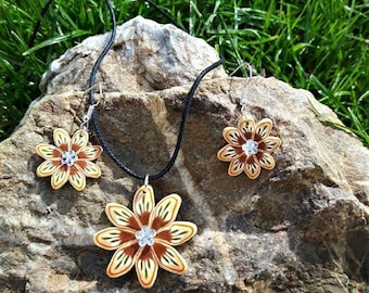Beige, Brown, green and orange flowers set made of polymer clay.