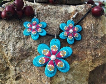 Blue and pink flowers set made of polymer clay.