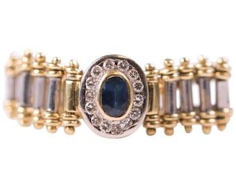 1980s Vintage Oval Sapphire and Diamond Halo 18 Karat Yellow/White Gold Flex Ring, VJ #100A