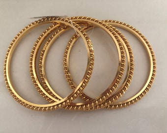 Gold plated bangles set of 4. Size 2.6