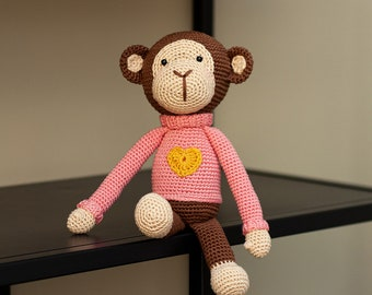 Crochet girl monkey with pink sweater