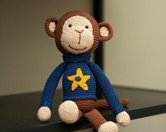 Crochet boy monkey with blue sweater