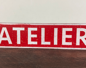 Small painted metal workshop plate - 28 x 7 cm