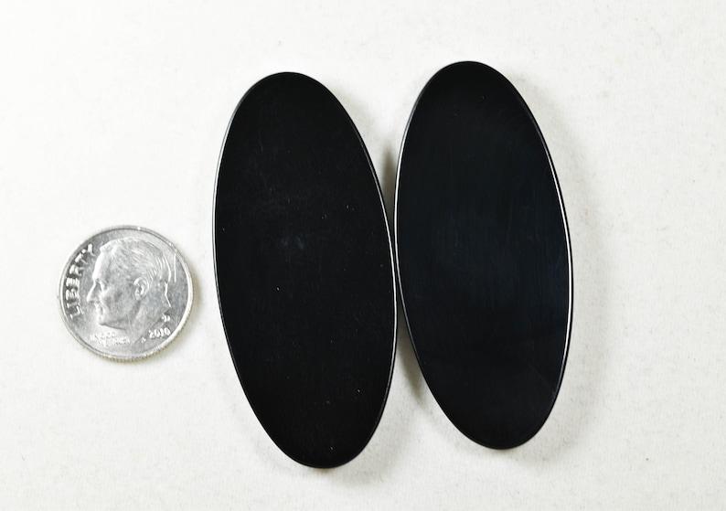 AAA Wyoming Black Jade designer cabochon pair