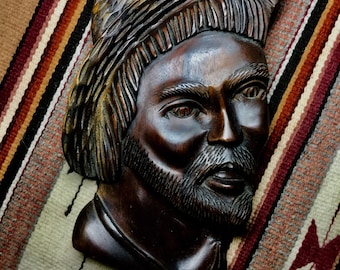Wall hanging of South American man