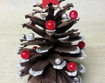 pine cone christmas tree giant pine cone natural tones with red and silver embellishment one of a kind - Decorating Large Pine Cones For Christmas
