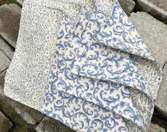 Placemats with the feel of spring in the air with the blue and white decor. These are lined, interlined and cooridinating fabric on back.