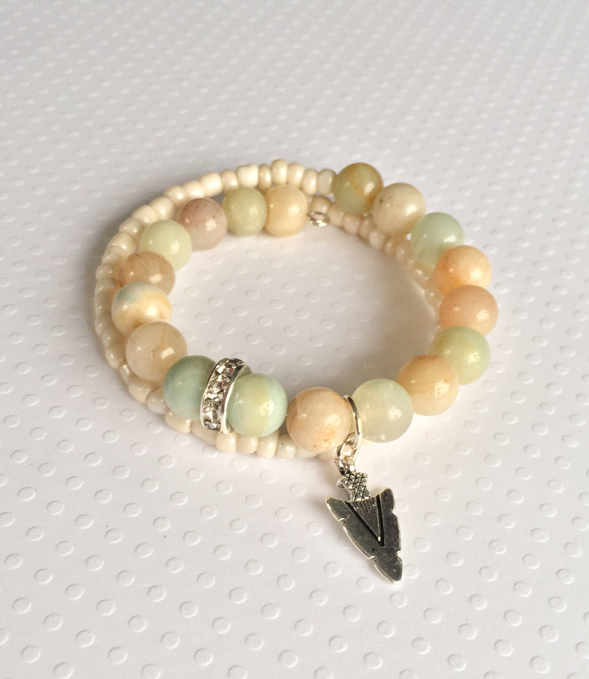 Neutral colored beaded double wrap bracelet with arrowhead charm ...
