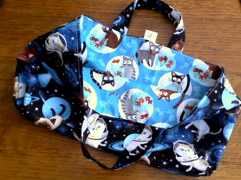 Fully reversible 100/% cotton bag with space cats one one side and the reverse side cats and goldfish