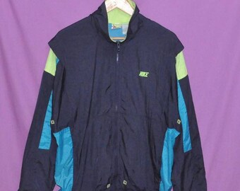 bb2d8e05ec44d9 Vintage 90s NIKE Grey Tag Multicolor Windbreaker Jacket Large Size