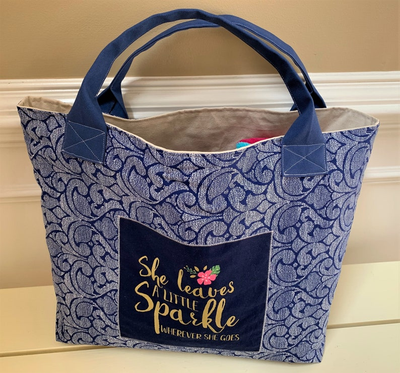 a Mermaid and an Inspirational Quote and Canvas Handles Large Mermaid Beach Bag Canvas Tote in Navy Print with two appliques