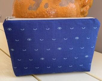 Blue Eyelashes Zippered Bag with Yellow Interior