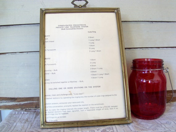 Vintage 7x10 brass picture frame with glass and brass ring on