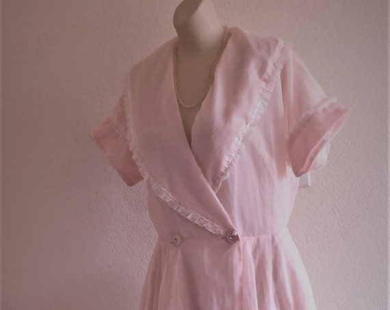 1950's baby pink, white swiss dot ankle length shirtwaist dress. Front wrap around ,2 pink button closure with necklace included  size MED