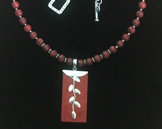 VTG Matte Oriental Red Jasper ,Pendant necklace with Sterling silver accents .Created by a well known New Mexico  Artist.  perfect present