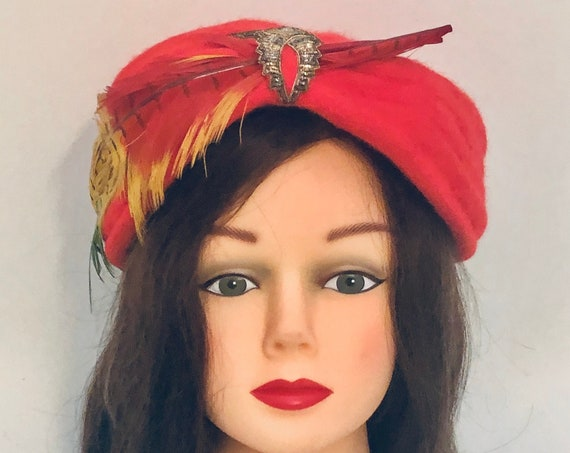 Vintage cherry red turban Evelyn Varon women's hat with multicolored two feathers and beautiful adornment in center