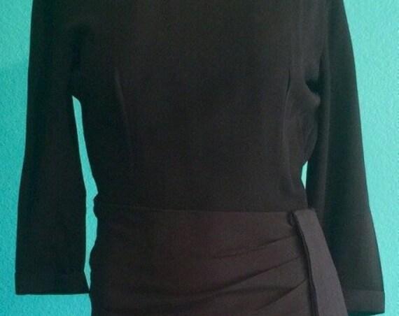Early 1950's black form fitting Jonathan Logan Dress.hip minimizing with big sash ,gorgeous Size small  55.00