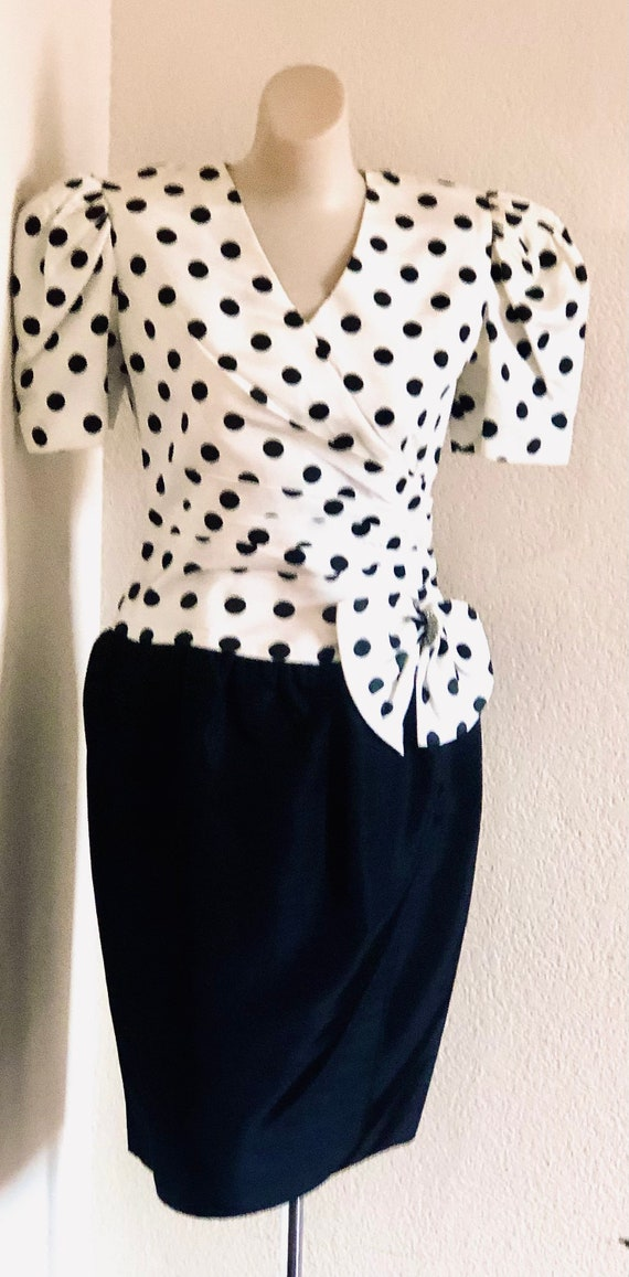 80's cocktail dress.black and white polka dot top, open solid black skirt.below the knee drop waist.side bow with rhinestone accent.size 5-6