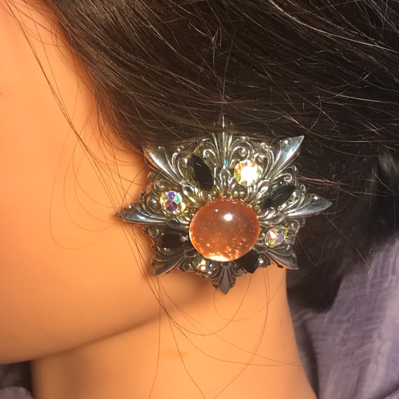 Mid Century silver outrageous, starburst clip on earrings  ,  clear and black rhinestones  with  round peach sparking center , great present