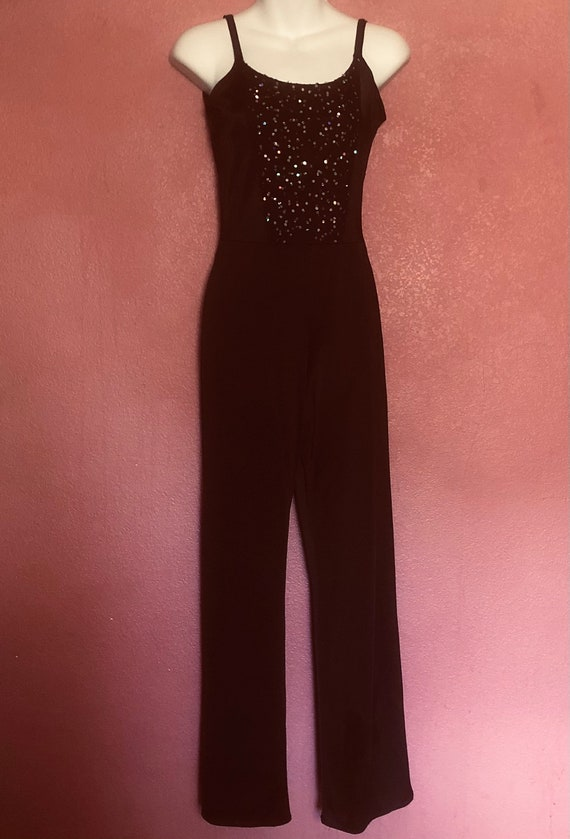 1970's jumpsuit black sexy mod sparkly top simple form fitting ,romper with sparkles on the front top. Bell bottom legs. Small -Med