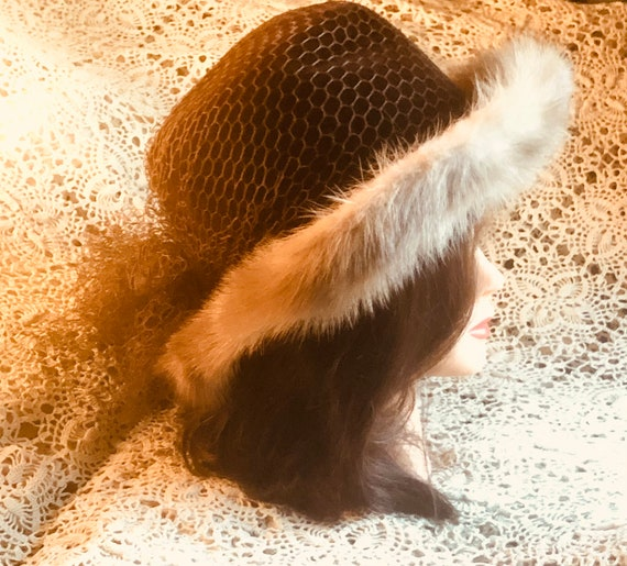 1950 mid century fedora winter hat. Made by Coralie. Chocolate velvet wool with mink trim.Brown netting tied in a bow in back