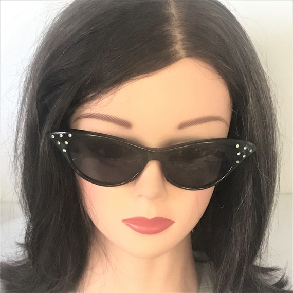 1960's Black cat eye sexy sunglasses. vintage sunglasses with very dark lens, rhinestones on each temple. Feminine, Rockabilly  Pin-Up