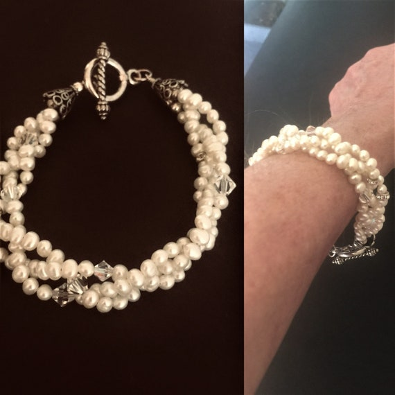 Real freshwater 3 woven strand white pearl bracelet with swarovski crystals. Size- large   custom created .Sterling silver closure   35.00