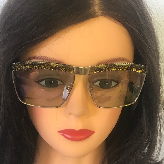 1960's Movie Star over sized sunglasses Catherine Deneuve  dazzling square black and gold frames, with glass lens  that change colors .
