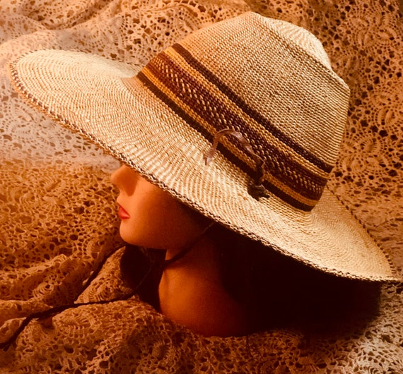 Vintage Toucan hat floppy, wide brim,natural colored reenforced straw sun hat with an under chin tie.