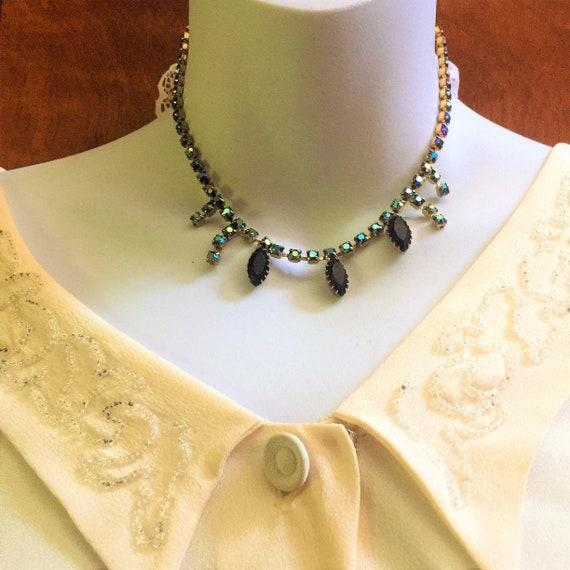 vintage  1960s Czech deep purple aurora borealis glass necklace.One strand that has extending lengths.28.00  beautiful!