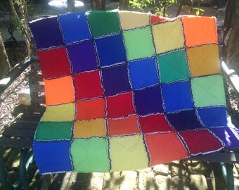 Rainbow rag edge play size quilt made from recycled T-shirts