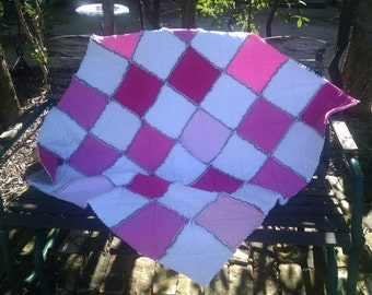 Pink and white rag edge play size quilt made from recycled T-shirts