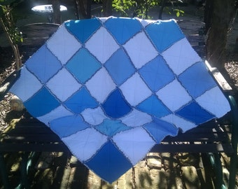 Blue and white rag edge play size quilt made from recycled T-shirts