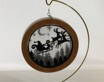3-D Santa's Flight  Silhouette Ornament; 2021 Charm, Christmas  Shadowbox Ornament; Cherry Stain Wood - IPFG-000310