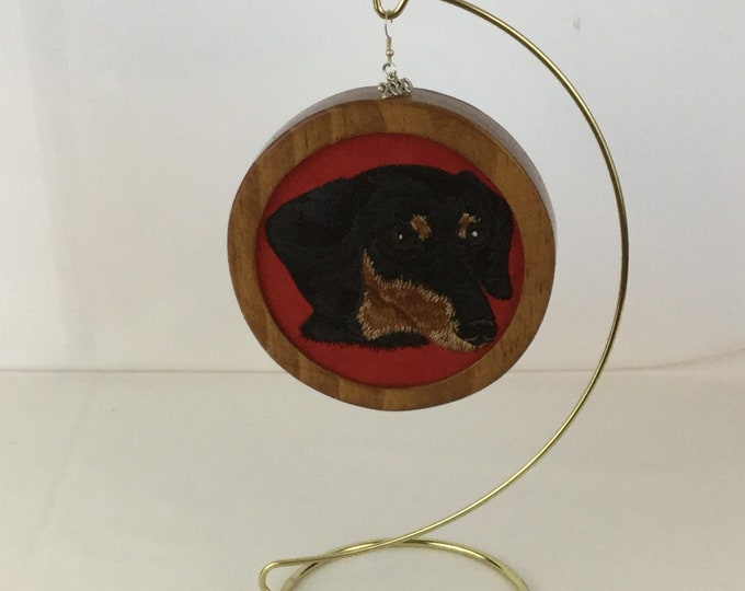 Dachshund Head Ornament; My Kid's Have 4 Feet, Charm, on Red Faux Suede Fabric with a Cherry Stain Wood Frame-IPFG-000380