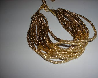12 strand seed bead bracelet in gold and bronze