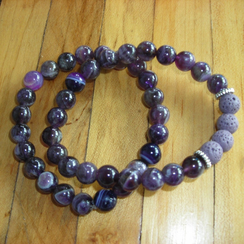 6mm Amethyst bracelet withwithout lava rock diffuser beads and silver spacers.Amethyst is natural stress reliever,attracts positive energy.