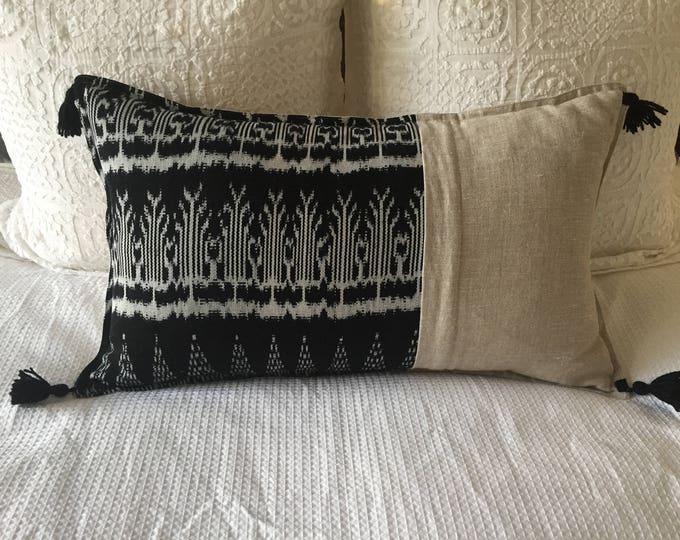 Fair Trade Artisan Lumbar Cushion Cover featuring Black Ikat Textile + Natural Washed Eco Friendly Linen + Australian Merino Wool Tassels