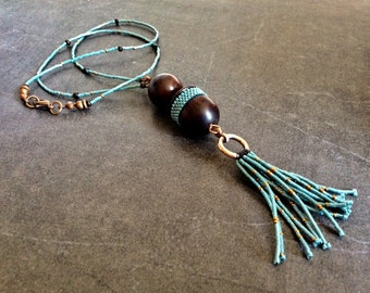 #608 necklace made of rosewood, micro glass beads and copper metal elements.